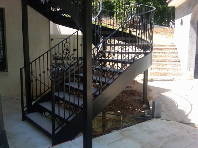 Outdoor cast wrought iron spiral staircase